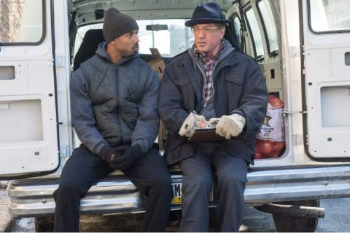 """This photo provided by Warner Bros. Pictures shows Michael B. Jordan, left, as Adonis Johnson and Sylvester Stallone as Rocky Balboa in Metro-Goldwyn-Mayer Pictures', Warner Bros. Pictures' and New Line Cinema's drama """"Creed,"""" a Warner Bros. Pictures release. (Barry Wetcher/Warner Bros. Pictures via AP)"""
