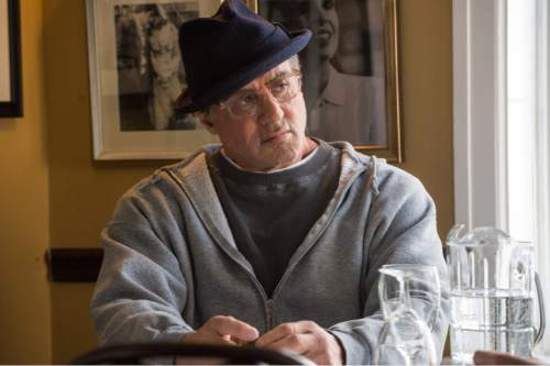 """This photo provided by Warner Bros. Pictures shows Sylvester Stallone as Rocky Balboa in Metro-Goldwyn-Mayer Pictures', Warner Bros. Pictures' and New Line Cinema's drama """"Creed,"""" a Warner Bros. Pictures release. (Barry Wetcher/Warner Bros. Pictures via AP)"""