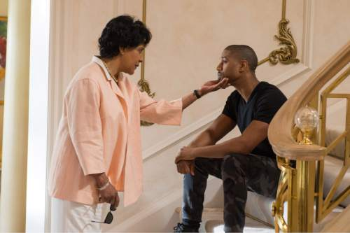 """This photo provided by Warner Bros. Pictures shows Michael B. Jordan, left, as Adonis Johnson and Phylicia Rashad as Mary Anne Creed in Metro-Goldwyn-Mayer Pictures', Warner Bros. Pictures' and New Line Cinema's drama """"Creed,"""" a Warner Bros. Pictures release. (Barry Wetcher/Warner Bros. Pictures via AP)"""