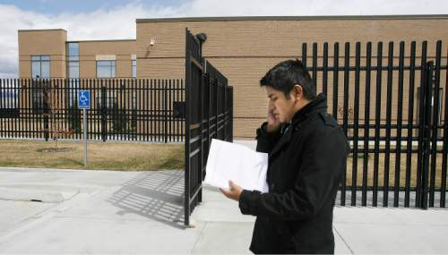 Tribune File Photo  Deyvid, formerly David, Morales stands outside the ICE offices on Decker Lake Drive, delivers his complaint  against  agency by telephone. He had hoped to deliver a complaint against the agency in person; but was told he would have to read his complaint over the telephone and by Email.  Monday, March 26, 2012.