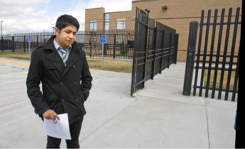 Tribune File Photo  Deyvid, formerly David, Morales standing outside the ICE offices on Decker Lake Drive. He had hoped to deliver a complaint against the agency in person; but was told he would have to read his complaint over the telephone and by Email on Monday, March 26, 2012.