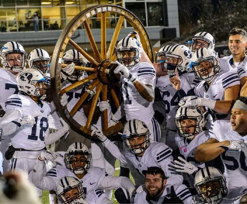 Trent Nelson  |  The Salt Lake Tribune BYU players pose after the win as Utah State hosts BYU, NCAA football in Logan, Saturday November 28, 2015.