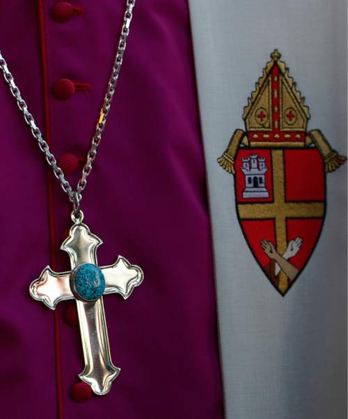 Leah Hogsten  |  The Salt Lake Tribune The new crucifix given to Archbishop John C. Wester by Most Rev. Michael J. Sheehan Archbishop of Santa Fe during Vespers Wednesday, June 3, 2015 at the Cathedral Basilica of St. Francis of Assisi in Santa Fe and Wester's  Rite of Reception of the Archbishop in his Cathedral Church.