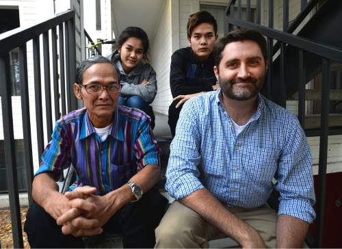 Steve Griffin  |  The Salt Lake Tribune  Aster Paw, 19, top left, and Nay Ree, 21, with their father Pah De Paw, left, and volunteer Alan Gardner who mentors the refugee family who are originally from Myanmar, formerly called Burma. Photo was taken at their home  in Salt Lake City, Tuesday, November 24, 2015.