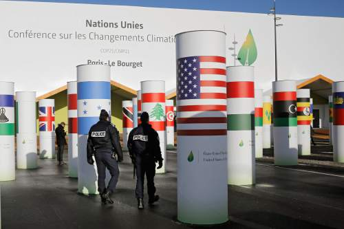 Policemen patrol outside the main entrance of the United Nations Climate Change Conference in Le Bourget, outside Paris, Saturday, Nov. 28, 2015. The site of Paris-Le Bourget will officially become  United Nations territory for the COP 21 conference which is  scheduled to start on Nov. 30. (AP Photo/Laurent Cipriani)