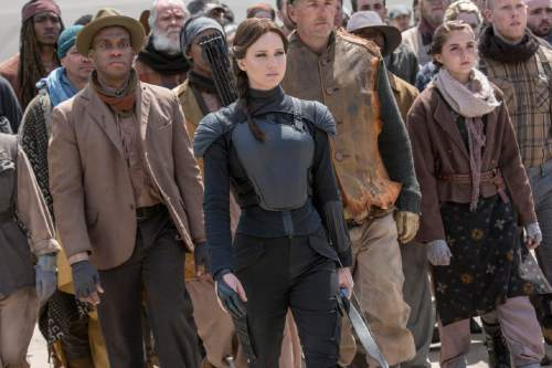 """This image released by Lionsgate shows Jennifer Lawrence as Katniss Everdeen, center, in a scene from """"The Hunger Games: Mockingjay Part 2."""" (Murray Close/Lionsgate via AP)"""