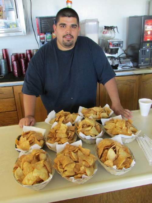 Tom Wharton  |  The Slat Lake Tribune   Jorge Escobedo is one of the friendly staff at the Salt Flats Cafe who never writes down an order.