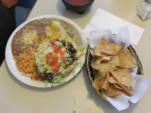 Tom Wharton  |  The Slat Lake Tribune   The Pancho Special that includes a chile verde burrito, steak tostada, steak enchilada, rice and beans, is a specialty at the Salt Flats Cafe near the Bonneville Salt Flats.
