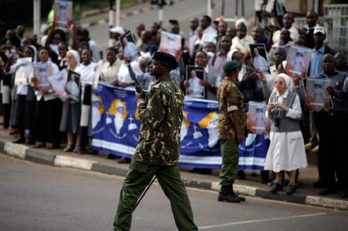 Soldiers patrol as people wait for the arrival of Pope Francis, in Nairobi's State House, Wednesday, Nov. 25, 2015. Brushing aside concerns for his security, Pope Francis arrived in Kenya on Wednesday for his first-ever visit to Africa, including to Central African Republic, a country torn by fighting between Christian and Muslims. (AP Photo/Andrew Medichini)