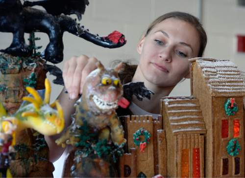 Al Hartmann  |  The Salt Lake Tribune Kelsee Bell, culinary student at the Women's Correctional puts finishing touches on a gingerbread dragon figure.  It's a part of a second gingerbread display made in celebration of animated movies; Box Trolls, How to Train Your Dragon, Home, and Inside Out.  It will be donated to the Festival of Trees.