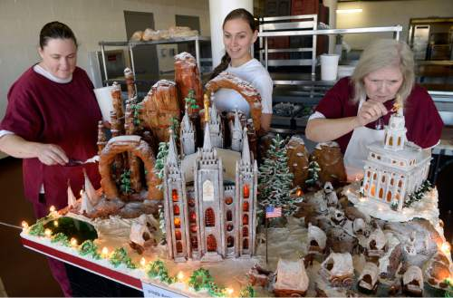 Al Hartmann  |  The Salt Lake Tribune Sally Krivanek, left, Kelsee Bell and Robin Radcliff, culinary students at the Women's Correctional put finishing touches on a massive gingerbread display before being transported to the South Towne Center and donated to the Festival of Trees.  This year's theme is Utah History, featuring the Nauvoo Temple, Mormon wagon train and the Salt Lake Temple.