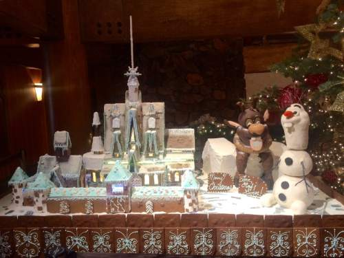 """The Arendelle gingerbread scene from """"Frozen' features more than 400 pounds of gingerbread, 250 pounds of sugar to create the frozen look over the castle, 50 pounds of sugar for the frozen fjord and 30 pounds of fondant."""