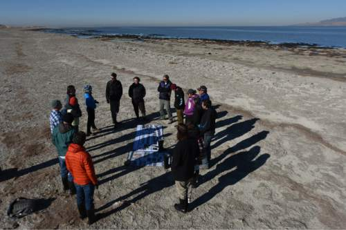 Francisco Kjolseth | The Salt Lake Tribune Researchers gather at The Great Salt Lake to study small rock like structures formed by cyanobacteria known as microbialites. These domed structures cover about 386 square miles, nearly 23 percent of the lake's bed, and offer a glimpse of what the Earth was like for its first 3 billion years.