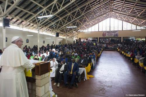 Pope Francis speaks during his visit to Kangemi, one of the 11 slums dotting Nairobi, Kenya, Friday, Nov. 27, 2015. Pope Francis denounced the conditions slum-dwellers are forced to live in, saying Friday that access to safe water is a basic human right and that everyone should have dignified, adequate housing. (L'Osservatore Romano/Pool Photo via AP)