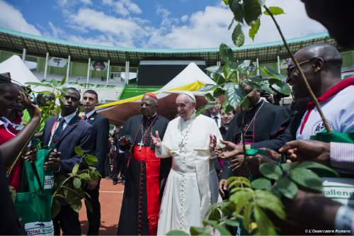 Pope Francis arrives at the Kasarani Stadium, in Nairobi, Kenya, Friday, Nov. 27, 2015. Pope Francis is in Africa for a six-day visit that is taking him to Kenya, Uganda and the Central African Republic. Pope Francis denounced the conditions slum-dwellers are forced to live in, saying Friday that access to safe water is a basic human right and that everyone should have dignified, adequate housing. (L'Osservatore Romano/Pool Photo via AP)