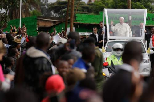 Pope Francis arrives to visit the Kangemi neighborhood, in Nairobi, Kenya, Friday, Nov. 27, 2015. Pope Francis is in Africa for a six-day visit that is taking him to Kenya, Uganda and the Central African Republic. (AP Photo/Andrew Medichini)