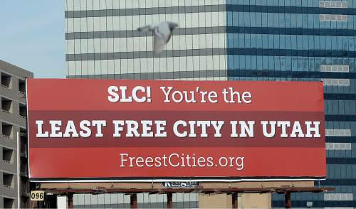 "Al Hartmann  |  The Salt Lake Tribune Billboard along 400 South at 249  East in Salt Lake City by Libertas Institute, a libertarian organization, has named Salt Lake City the least ""free"" city in Utah based on its evaluation of individual liberty, private property rights and free markets. Heber City was deemed the most free."