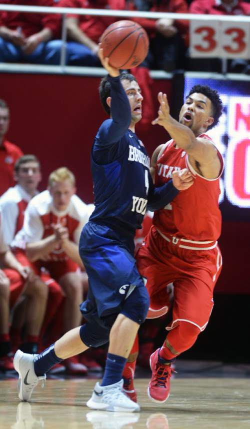 Steve Griffin  |  The Salt Lake Tribune  Brigham Young Cougars guard Nick Emery (4) passes away from Utah Utes guard Isaiah Wright (1) during first half action in the Utah versus BYU men's basketball game at the Huntsman Center in Salt Lake City, Wednesday, December 2, 2015.