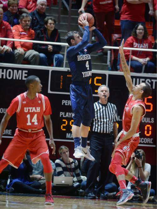 Steve Griffin  |  The Salt Lake Tribune  Brigham Young Cougars guard Nick Emery (4) fires a shot during second half action in the Utah versus BYU men's basketball game at the Huntsman Center in Salt Lake City, Wednesday, December 2, 2015.