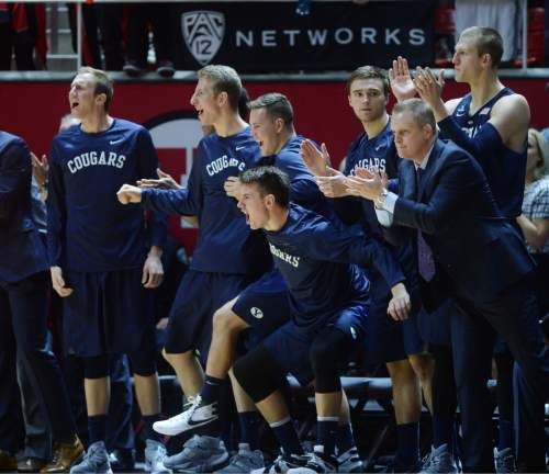 Steve Griffin  |  The Salt Lake Tribune  The BYU bench gets fired up as the Cougars cut into the lead during second half action in the Utah versus BYU men's basketball game at the Huntsman Center in Salt Lake City, Wednesday, December 2, 2015.
