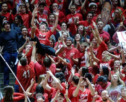 Steve Griffin  |  The Salt Lake Tribune  Utah fans throw each other up in the air as the Utes pull away from the Cougars during second half action in the Utah versus BYU men's basketball game at the Huntsman Center in Salt Lake City, Wednesday, December 2, 2015.