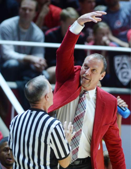 Steve Griffin  |  The Salt Lake Tribune  Utah head coach Larry Kyrstkowiak shows the referee how he thinks Brigham Young Cougars guard Nick Emery (4) was carrying the ball during first half action in the Utah versus BYU men's basketball game at the Huntsman Center in Salt Lake City, Wednesday, December 2, 2015.