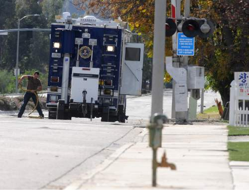 An FBI crime scene truck remains on scene at the Inland Regional Center in San Bernardino Calif. on Thursday, Dec. 3, 2015, after a mass shooting at the location on Wednesday. A heavily armed husband and wife dressed for battle opened fire on a holiday banquet for his co-workers Wednesday, killing multiple people and seriously wounding others in a precision assault, authorities said. Hours later, they died in a shootout with police. (James Quigg/Daily Press via AP)