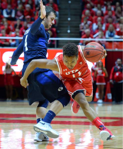 Steve Griffin  |  The Salt Lake Tribune  Utah Utes guard Brandon Taylor (11) drives past Brigham Young Cougars guard Nick Emery (4) during first half action in the Utah versus BYU men's basketball game at the Huntsman Center in Salt Lake City, Wednesday, December 2, 2015.