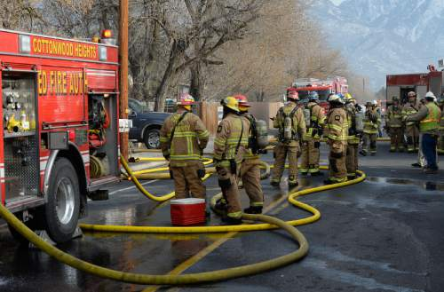 Francisco Kjolseth | The Salt Lake Tribune Unified Fire Crews clean up a house fire near 1900 E. Creek Road (about 7800 South) in Cottonwood Heights. The cause of the fire is under investigation.