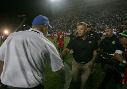 Rick Egan  | The Salt Lake Tribune   Brigham Young Cougars head coach Bronco Mendenhall shakes hands with Utah Utes head coach Kyle Whittingham after Utah beat BYU 20-13, at Lavell Edwards Stadium, Saturday, September 21, 2013.