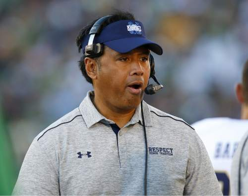 Navy head coach Ken Niumatalolo talks with his team during the second half of an NCAA college football game against Notre Dame, Saturday, Oct. 10, 2015, in South Bend, Ind. Notre Dame won the game 41-24. (AP Photo/Jeff Haynes)