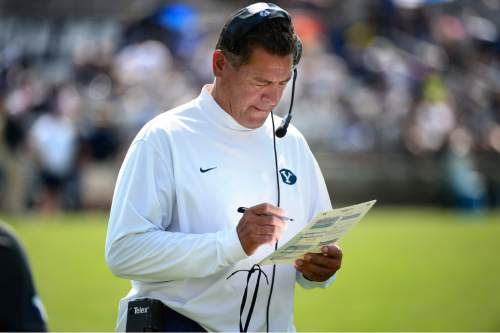 Scott Sommerdorf   |  The Salt Lake Tribune BYU offensive coordinator Robert Anae checks his list of plays during practice, Saturday, August 22, 2015.