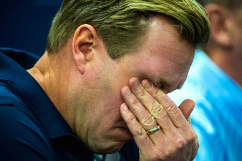 Chris Detrick  |  The Salt Lake Tribune Cougar football head coach Bronco Mendenhall wipes away a tear during a press conference at Brigham Young University Friday December 4, 2015.  Mendenhall signed a five-year contract with the University of Virginia that will pay him $3.25 million annually, estimated to be more than three times the money he makes coaching BYU.