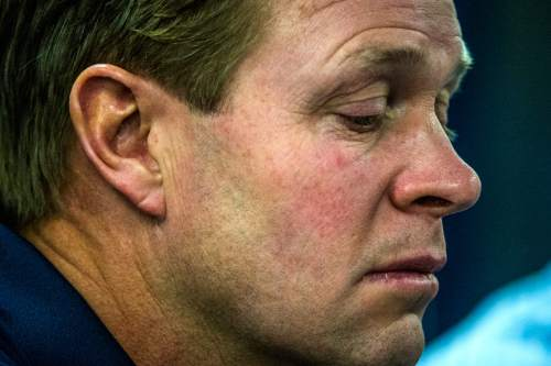 Chris Detrick     The Salt Lake Tribune Cougar football head coach Bronco Mendenhall listens during a press conference at Brigham Young University Friday December 4, 2015.  Mendenhall signed a five-year contract with the University of Virginia that will pay him $3.25 million annually, estimated to be more than three times the money he makes coaching BYU.