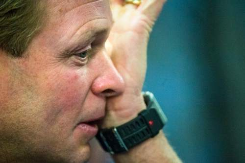 Chris Detrick     The Salt Lake Tribune Cougar football head coach Bronco Mendenhall wipes his eye during a press conference at Brigham Young University Friday December 4, 2015.  Mendenhall signed a five-year contract with the University of Virginia that will pay him $3.25 million annually, estimated to be more than three times the money he makes coaching BYU.