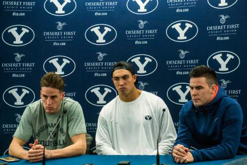 Chris Detrick  |  The Salt Lake Tribune Mitch Mathews, Bronson Kaufusi and Tanner Mangum during a press conference at Brigham Young University Friday December 4, 2015.  Mendenhall signed a five-year contract with the University of Virginia that will pay him $3.25 million annually, estimated to be more than three times the money he makes coaching BYU.