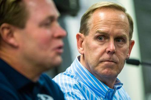 Chris Detrick  |  The Salt Lake Tribune Athletic Director Tom Holmoe listens as Cougar football head coach Bronco Mendenhall speaks during a press conference at Brigham Young University Friday December 4, 2015.  Mendenhall signed a five-year contract with the University of Virginia that will pay him $3.25 million annually, estimated to be more than three times the money he makes coaching BYU.