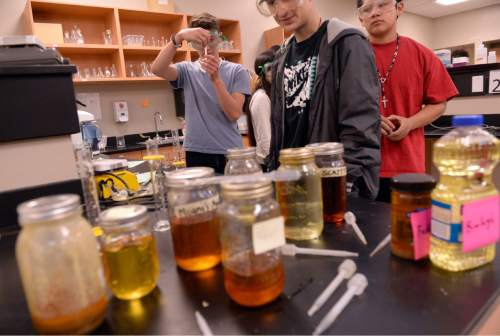 Al Hartmann  |  The Salt Lake Tribune  Tenth-grade students at the Salt Lake Center for Science Education do experiments making biodiesel from used cooking oils from local restaurants Tuesday April 7, 2015. The state school board will vote this week on advancing new science standards that emphasize engineering and hands-on experimentation.