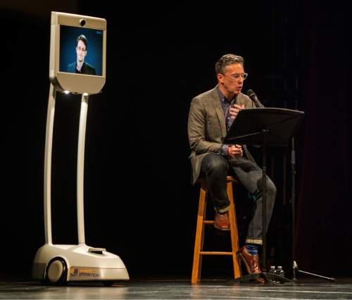 Rick Egan  |  The Salt Lake Tribune Edward Snowden speaks live via satellite to an audience, moderated by Doug Fabrizio, at the Eccles Center in Park City on Saturday.