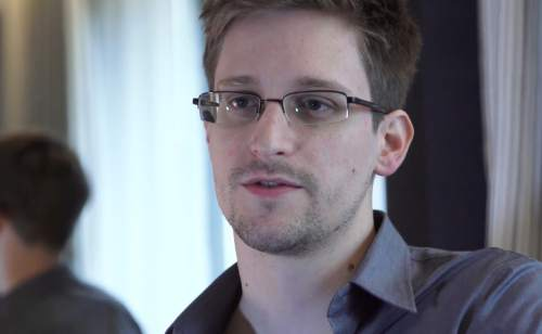 FILE - In this June 9, 2013 file photo provided by The Guardian Newspaper in London shows Edward Snowden, who worked as a contract employee at the National Security Agency, in Hong Kong.  (AP Photo/The Guardian, Glenn Greenwald and Laura Poitras, File)
