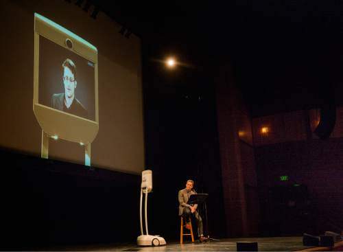 Rick Egan  |  The Salt Lake Tribune  Edward Snowden speaks live via satellite to a Park City audience, moderated by Doug Fabrizio, at the Eccles Center in Park City, Saturday, December 5, 2015.