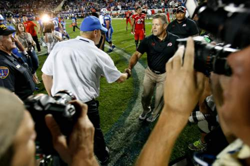 Trent Nelson  |  The Salt Lake Tribune Utah Utes head coach Kyle Whittingham shakes hands with Brigham Young Cougars head coach Bronco Mendenhall after the Utes won as the BYU Cougars host the Utah Utes, college football Saturday, September 21, 2013 at LaVell Edwards Stadium in Provo.