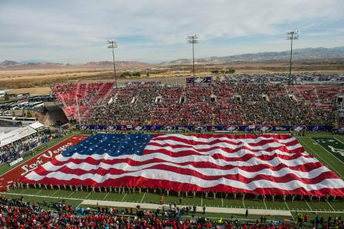 Chris Detrick  |  The Salt Lake Tribune A giant American Flag on display during the Royal Purple Las Vegas Bowl at Sam Boyd Stadium Saturday December 20, 2014. Utah is winning the game 24-10 at halftime.
