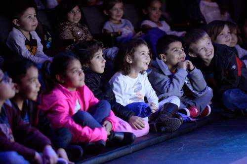 "Al Hartmann  |  The Salt Lake Tribune School children including those from Title 1 schools many of whom haven't had the opportunity to attend a live arts performance watch a matinee for ""Art Dog,"" the company's annual kids show based on a kids' book."