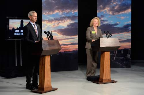 Scott Sommerdorf   |  Tribune file photo Mayoral candidates Ralph Becker and Jackie Biskupski get settled at their podiums during an October debate. The City Council has approved campaign-finance reforms that would put stricter limits on candidate donations in the future.