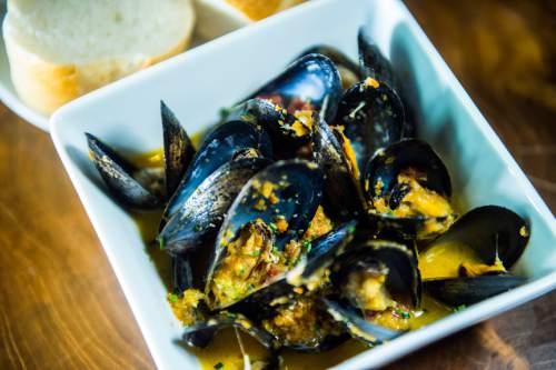 Chris Detrick  |  The Salt Lake Tribune Mejillones (mussels) with Spanish chorizo, sofrito and white wine ($15) at Finca Wednesday November 18, 2015.
