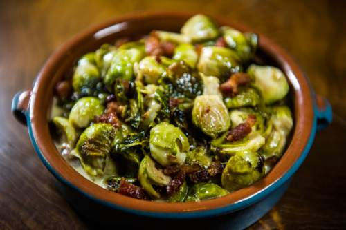Chris Detrick  |  The Salt Lake Tribune Bruselas con Tocino (brussels sprouts) with applewood smoked bacon and sherry cream ($10) at Finca on Nov. 18, 2015.