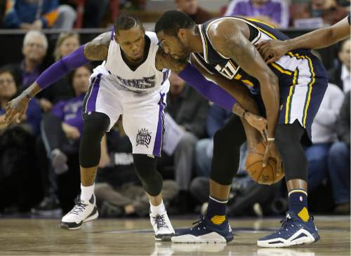 Sacramento Kings guard Ben McLemore, left, tries to steal the ball from Utah Jazz forward Derrick Favors during the second half of an NBA basketball game in Sacramento, Calif., Tuesday, Dec. 8, 2015. The Kings won 114-106. (AP Photo/Rich Pedroncelli)