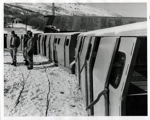 "Tribune file photo  The original caption on this 1966 photo says: ""Spiro Tunnel Train waits outside the tunnel, just prior to starting its 25 minutes, 15,000 foot ride into the tunnel."""