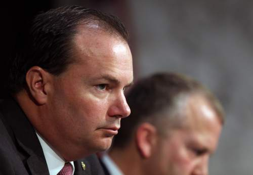 Sen. Mike Lee, R-Utah, listens during a Senate Armed Services Committee on July 21, 2015 on Capitol Hill in Washington. (AP Photo/Lauren Victoria Burke)